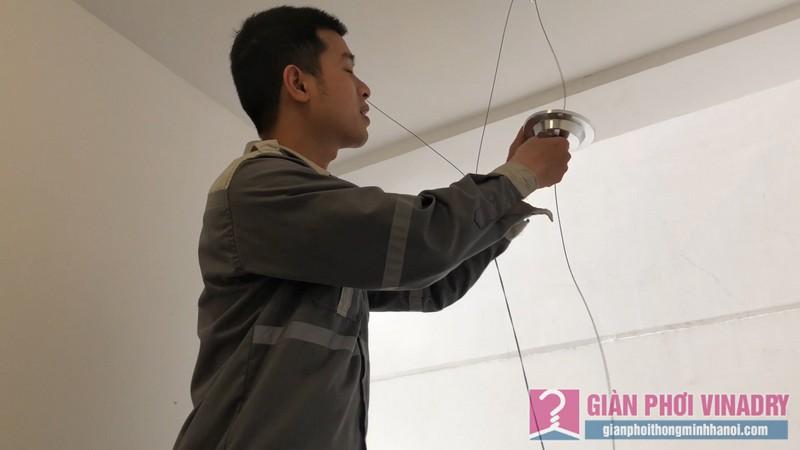 Đi dây cáp giàn phơi đồng thời lắp thêm bút úp bảo vệ buli