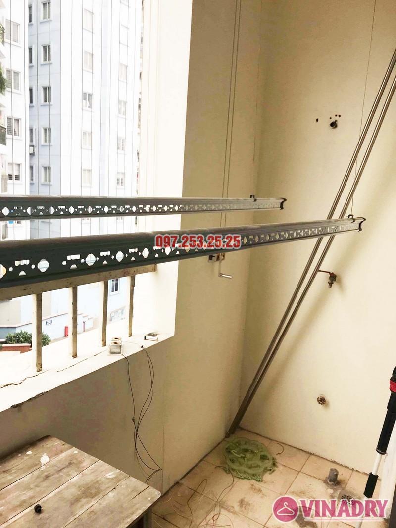 Thay củ quay, dây cáp giàn phơi thông minh giá rẻ tại nhà chị Thoa, chung cư 62 Trần Bình, Cầu giấy - 01